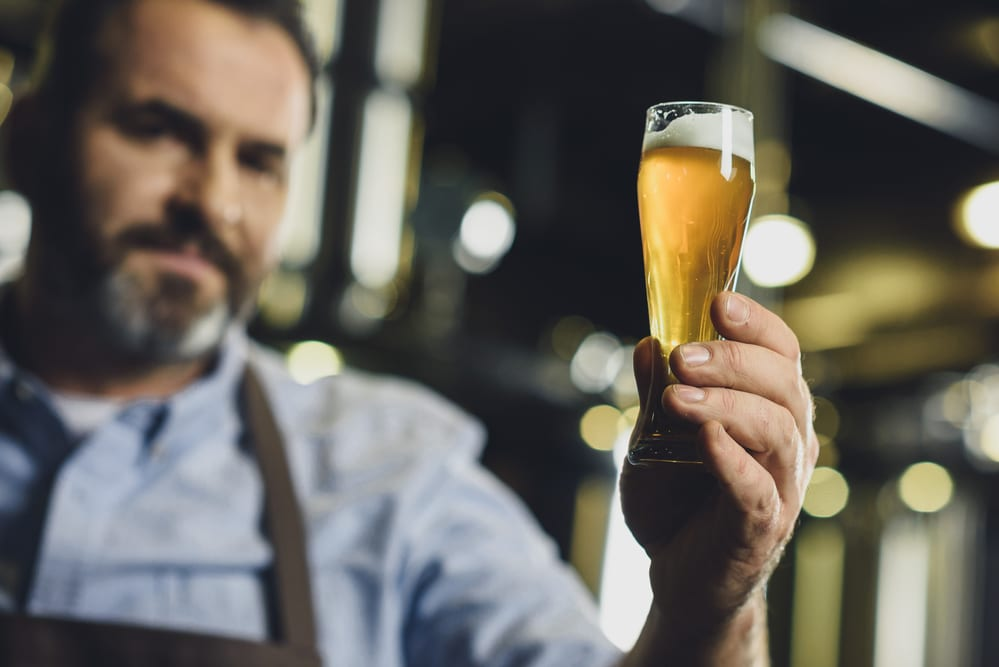 "A man holding a glass of beer — One of the premier events in Lewisville, Texas for the fall of 2018 is their ""Best Little Brewfest"""