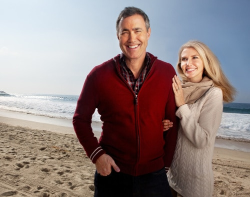 A happy older couple on the beach. Testosterone Replacement Therapy can help with erectile dysfunction, especially erectile strength. Learn more.