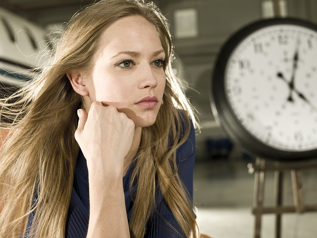 A long-haired woman sits with her head on her right fist, so looks worried, possibly about the effects of low estrogen on women.